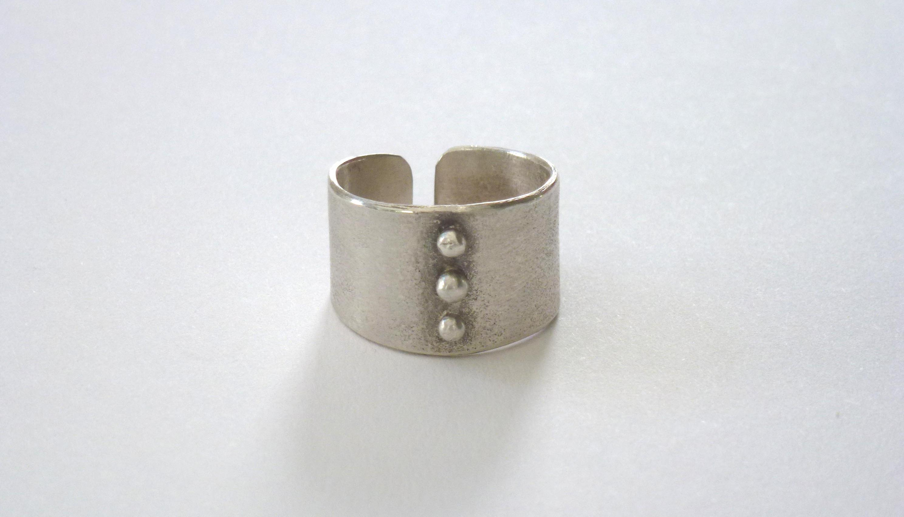silver wide band granulated ring